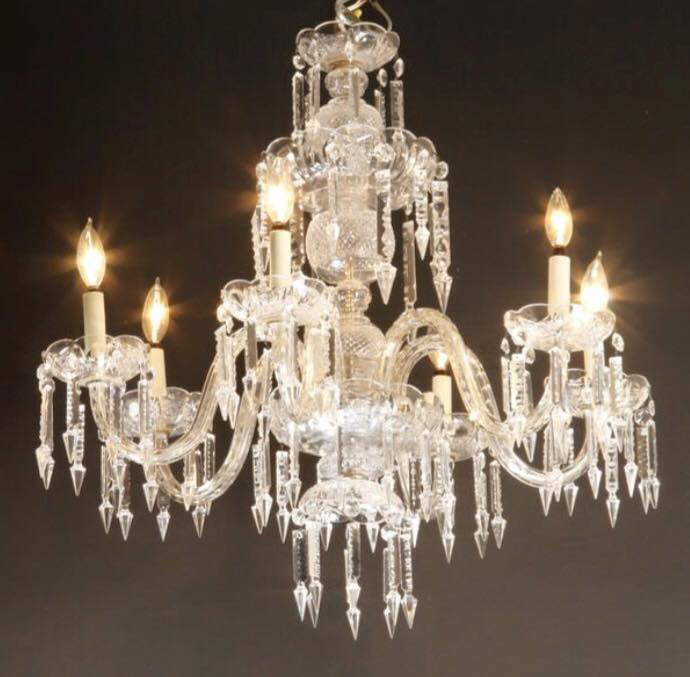 "A ""new"" chandelier for an old bedroom. We currently have 9 bedrooms in the mansion. The four bedrooms on the 3rd floor are being modernized for our younger sons and grandson (and they'll want Star Wars or professional sports teams or something!). But the five bedrooms on the second level will decorated with a turn-of-the-century look and feel. We bought this early 20th century beauty for one of them--thinking the smaller bedroom on the north side (the one that had the blue floral wallpaper). But this chandelier is only 24"" high and 30"" wide. Is it too small for a bedroom with 14ft ceilings? Or maybe it would look better with a long chain in the upstairs hallway leading to the servants stairs. All suggestions welcome! Even though it's smaller, its glass arms really caught our eye and we just had to buy it!"