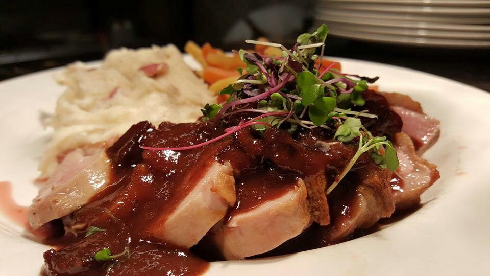 Burton's Grill - Pan-seared Duck Breast with Cherry Port Sauce.